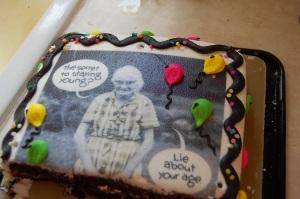 29 and Holding birthday cake