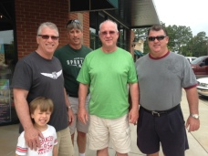 Ken with his brothers and grandson.