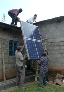 Installing solar panels to give the translators reliable electrical power.